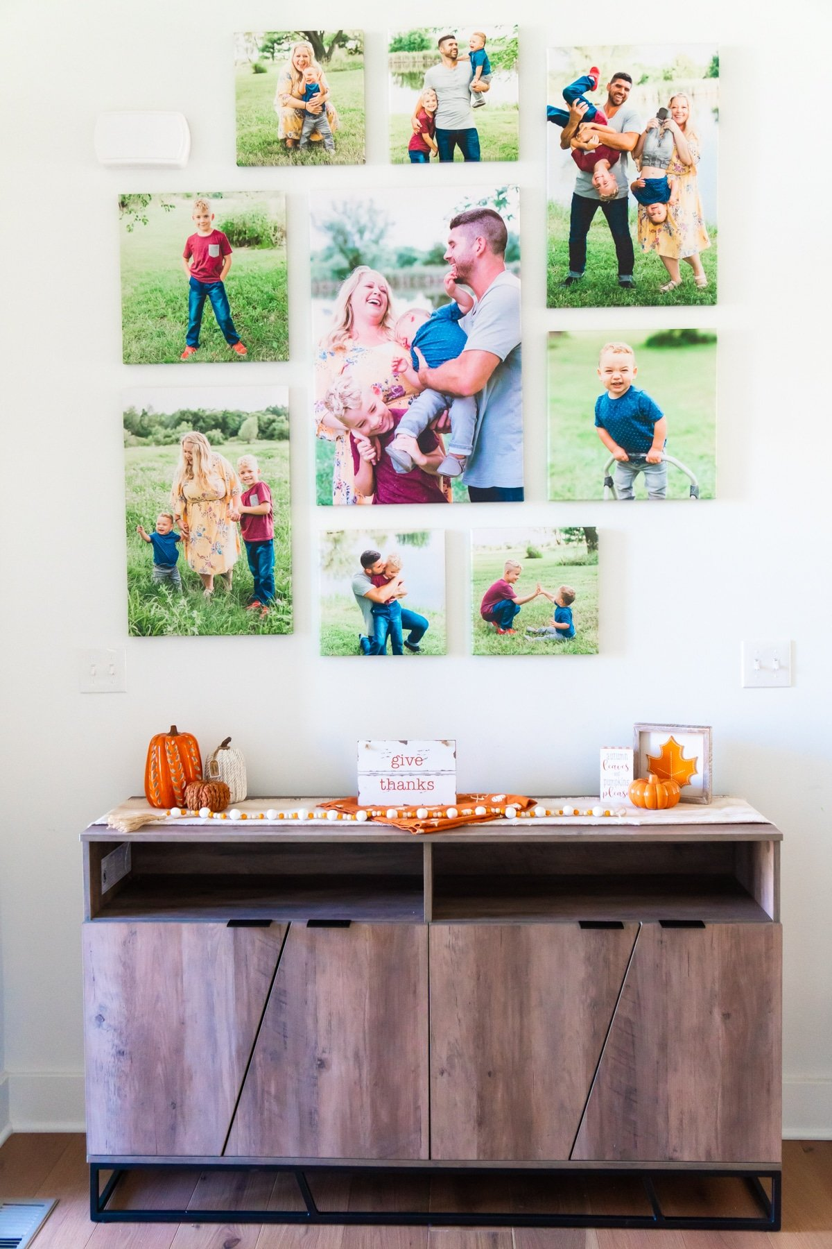 Photo wall above a fall decorated entry table