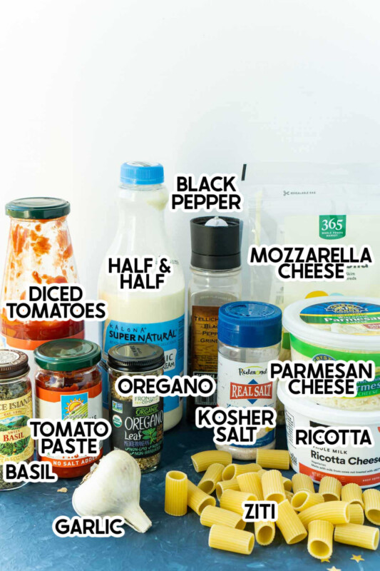Ziti, garlic, and other spices in a stack with labels