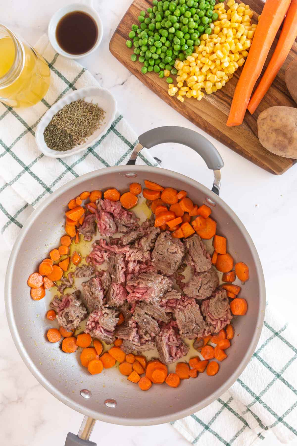 Metal saute pan with carrots and ground beef