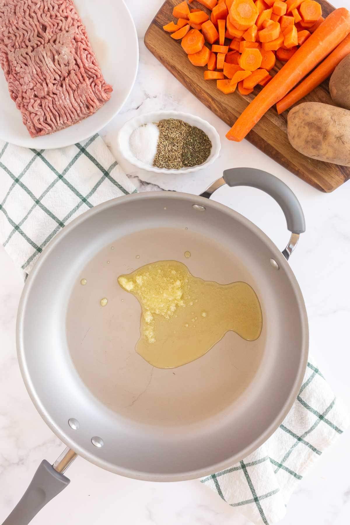 Ghee in a metal pan