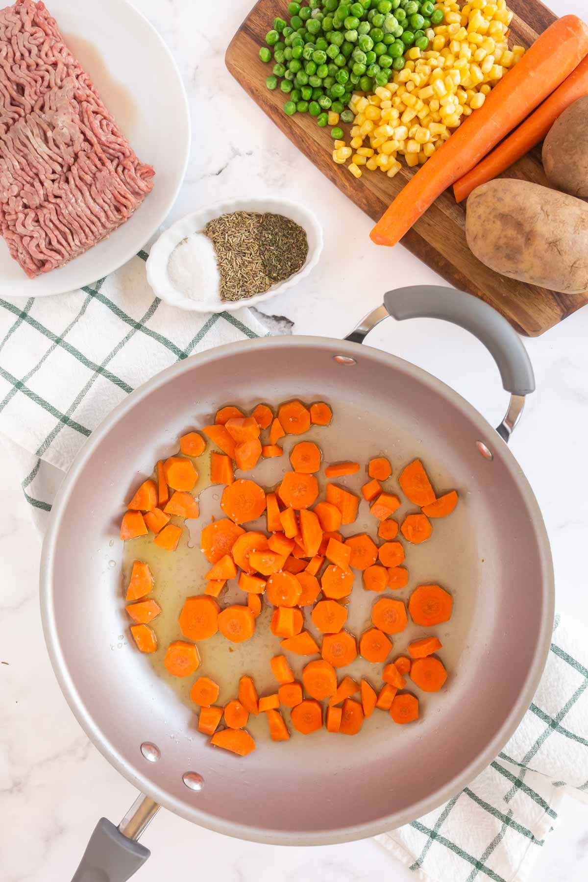 Metal pan with carrots cooking inside