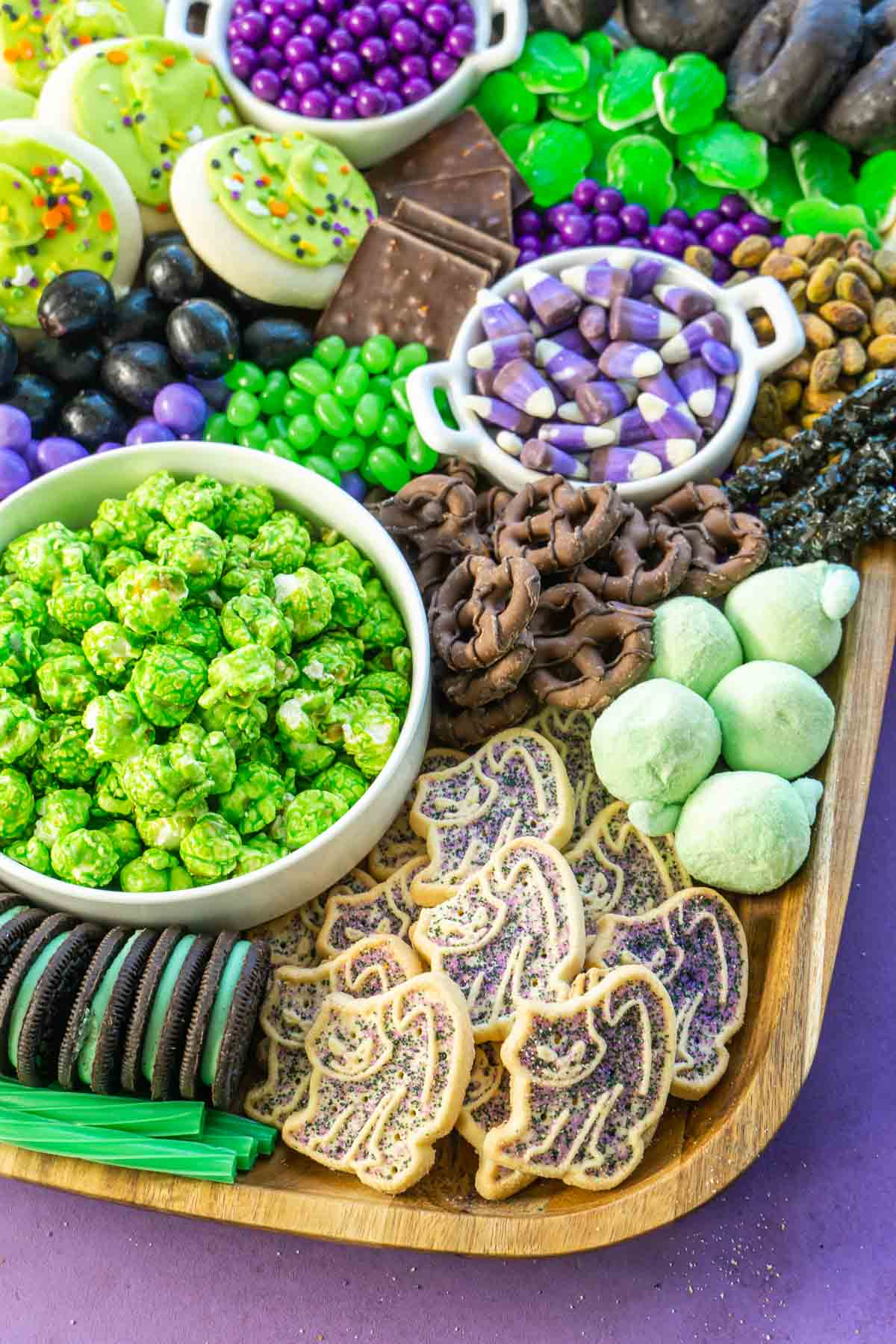 A close up image of a Halloween dessert board with cookies and candies