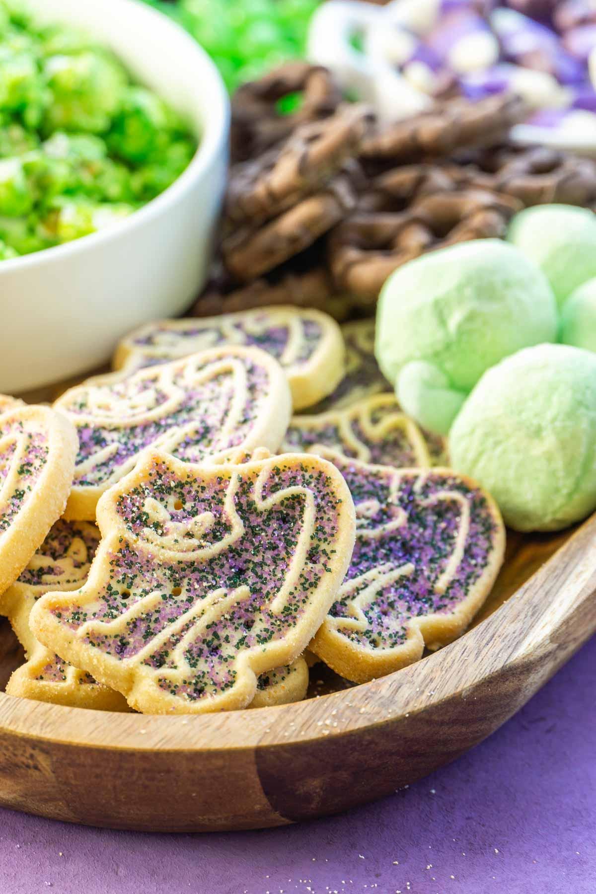 Purple cat cookies on a Halloween dessert board