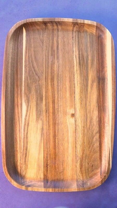 A wood board on a purple background