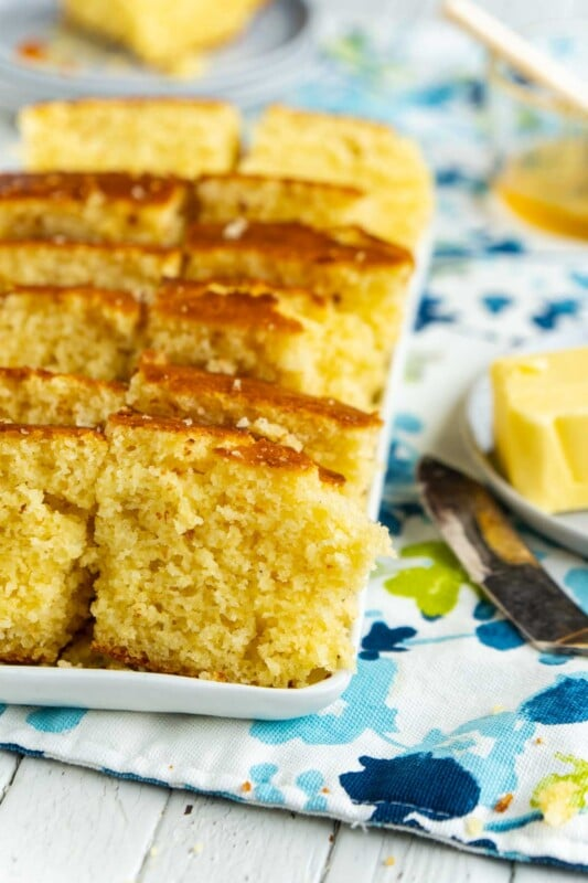 A white rectangle tray with pieces of sweet cornbread