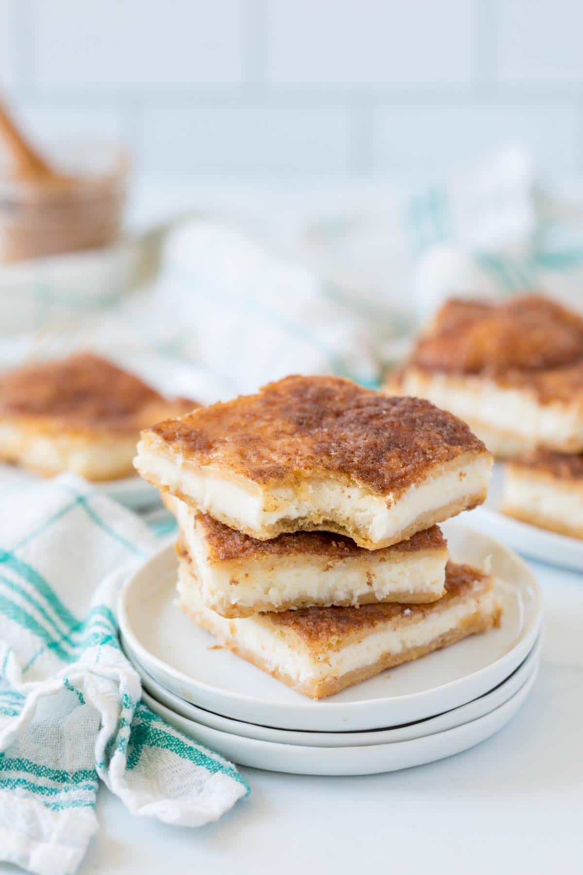 Three sopapilla cheesecake bars stacked on top of each other