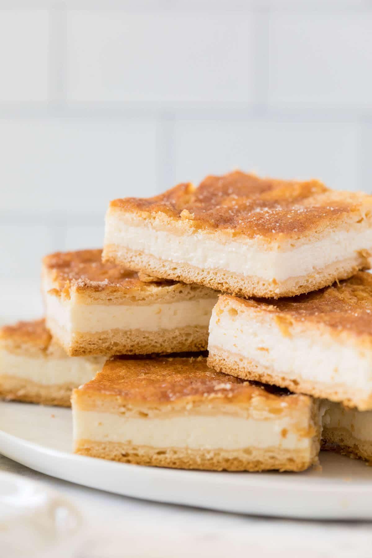 Sliced sopapilla cheesecake bars in a stack