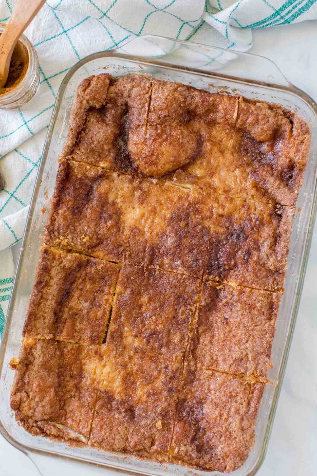 Sliced sopapilla cheesecake in a baking dish