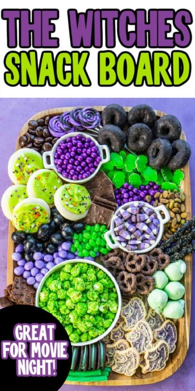Wood board with lots of purple and green snacks and text for Pinterest