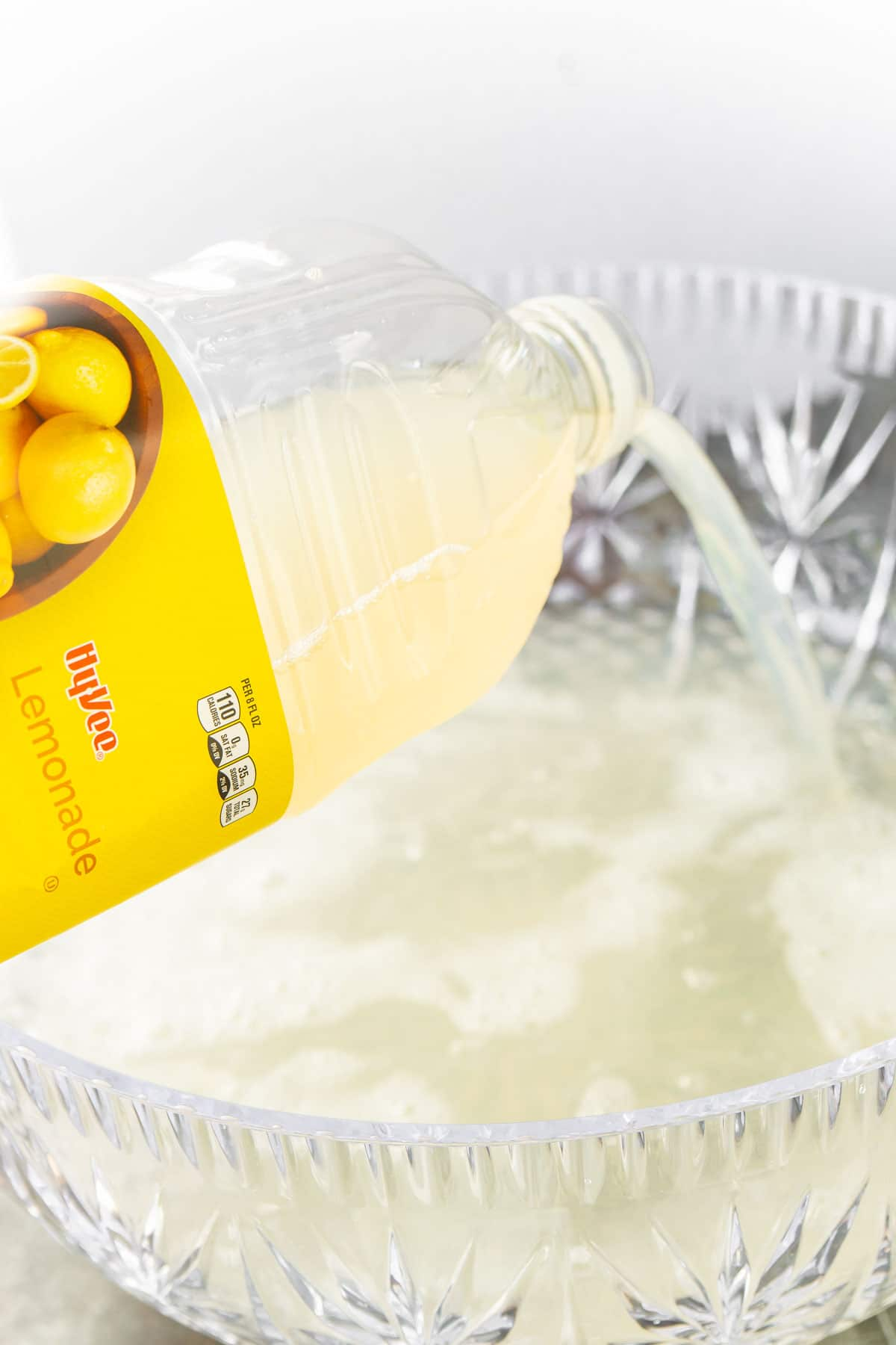 Lemonade being poured into a punch bowl