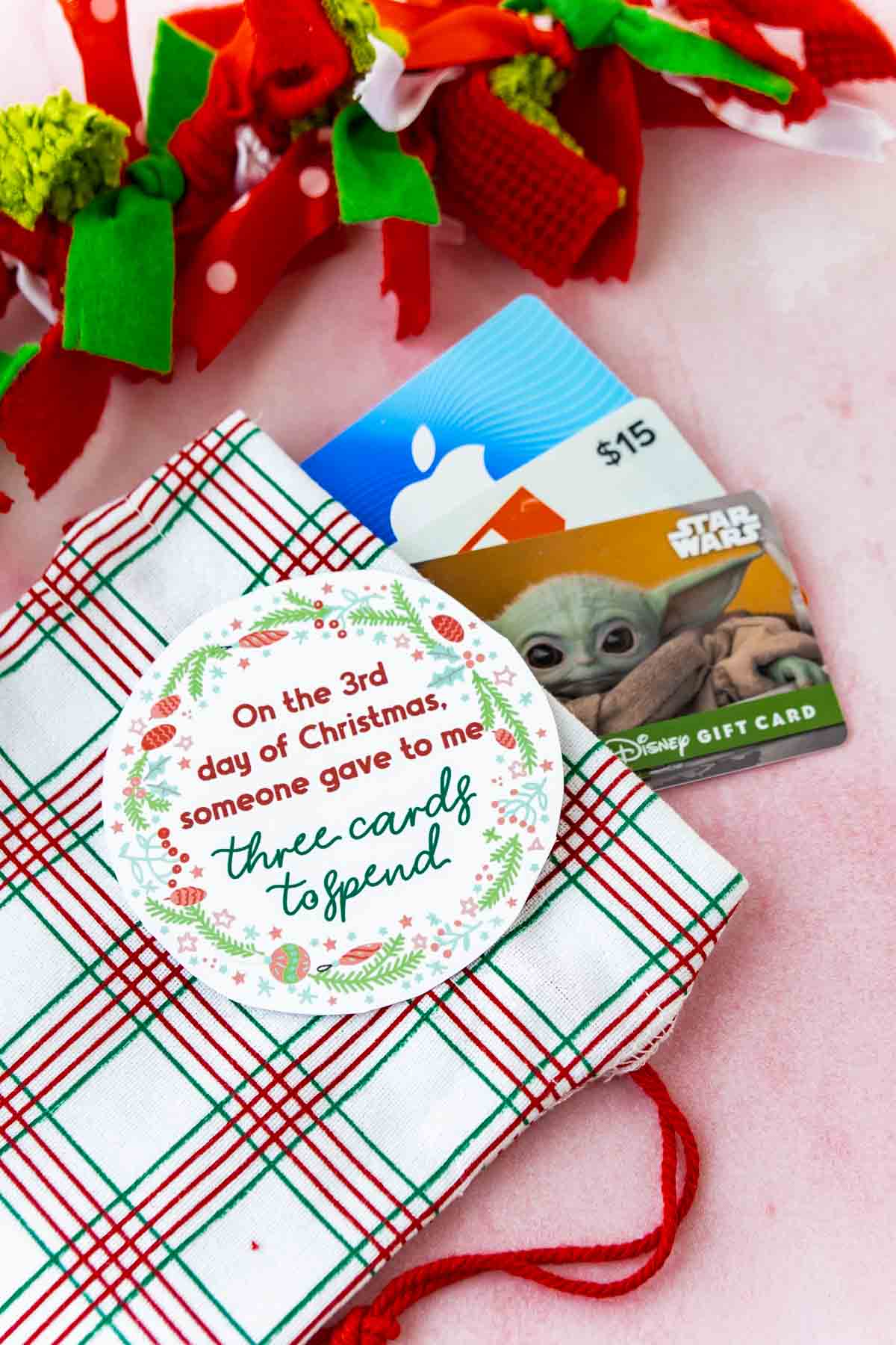 gift cards in a stocking with 12 days of christmas tags