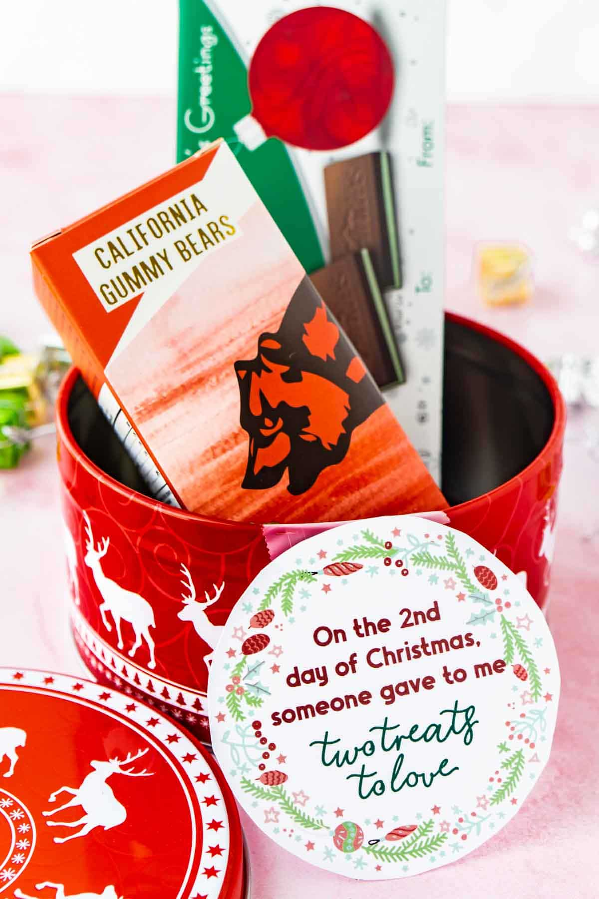 Tin with treats and 12 days of christmas tags taped on