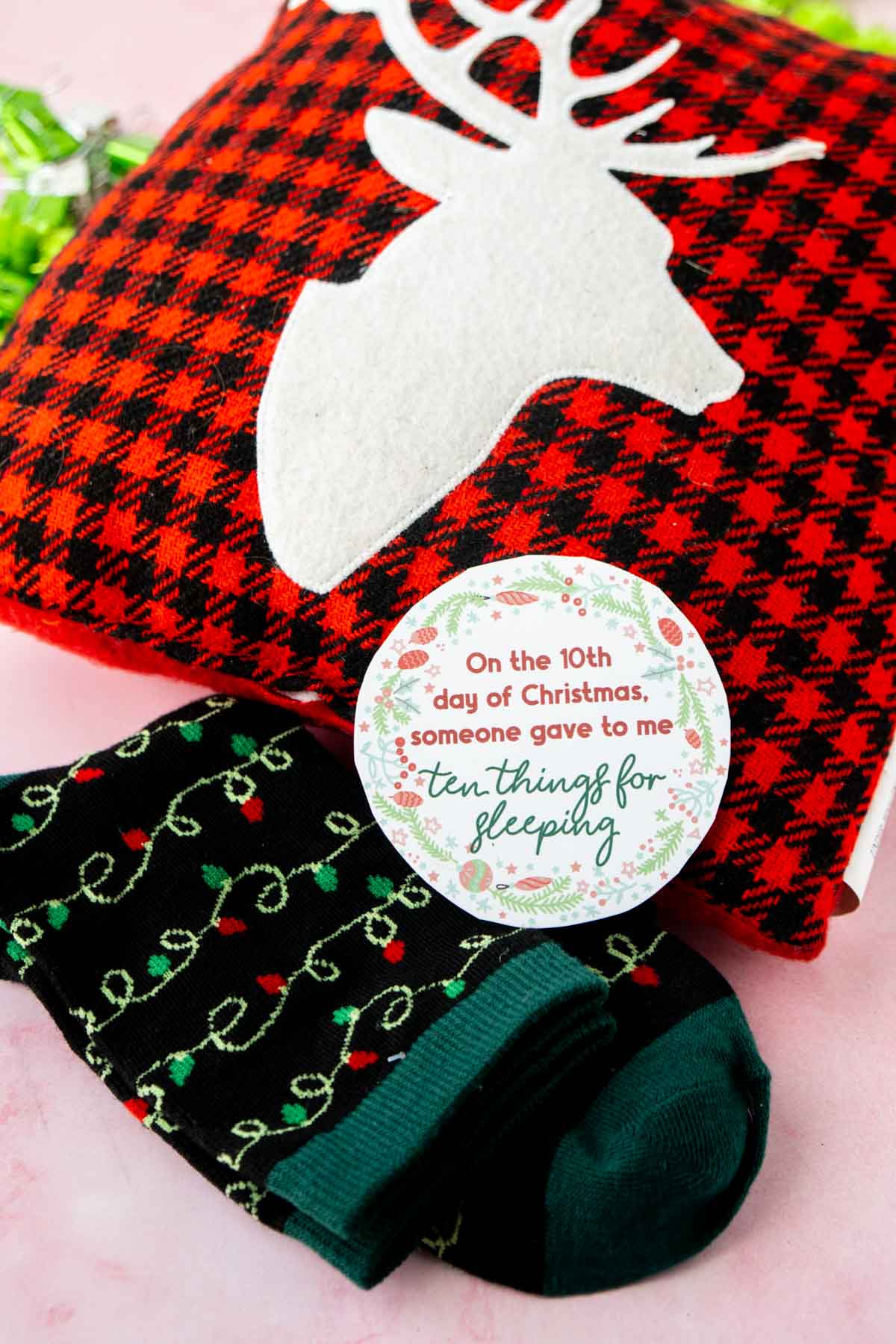12 days of Christmas tag on top of a pillow and socks