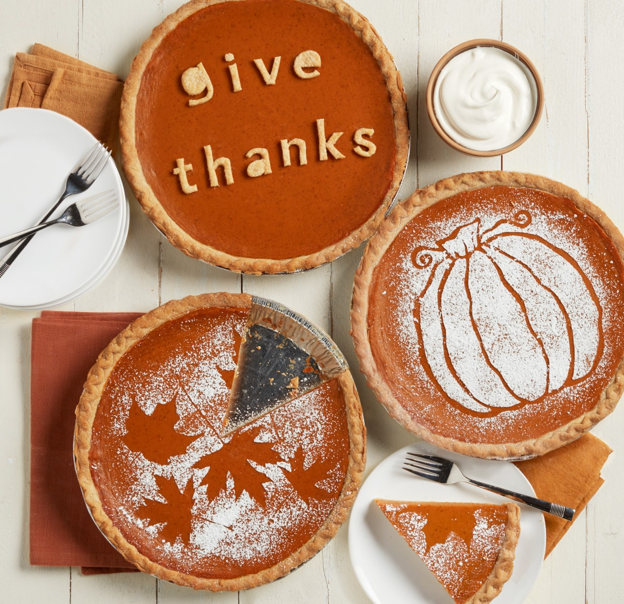 Three pumpkin pies with decorations on them