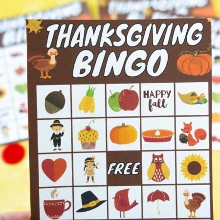 Woman's hand holding a Thanksgiving bingo card