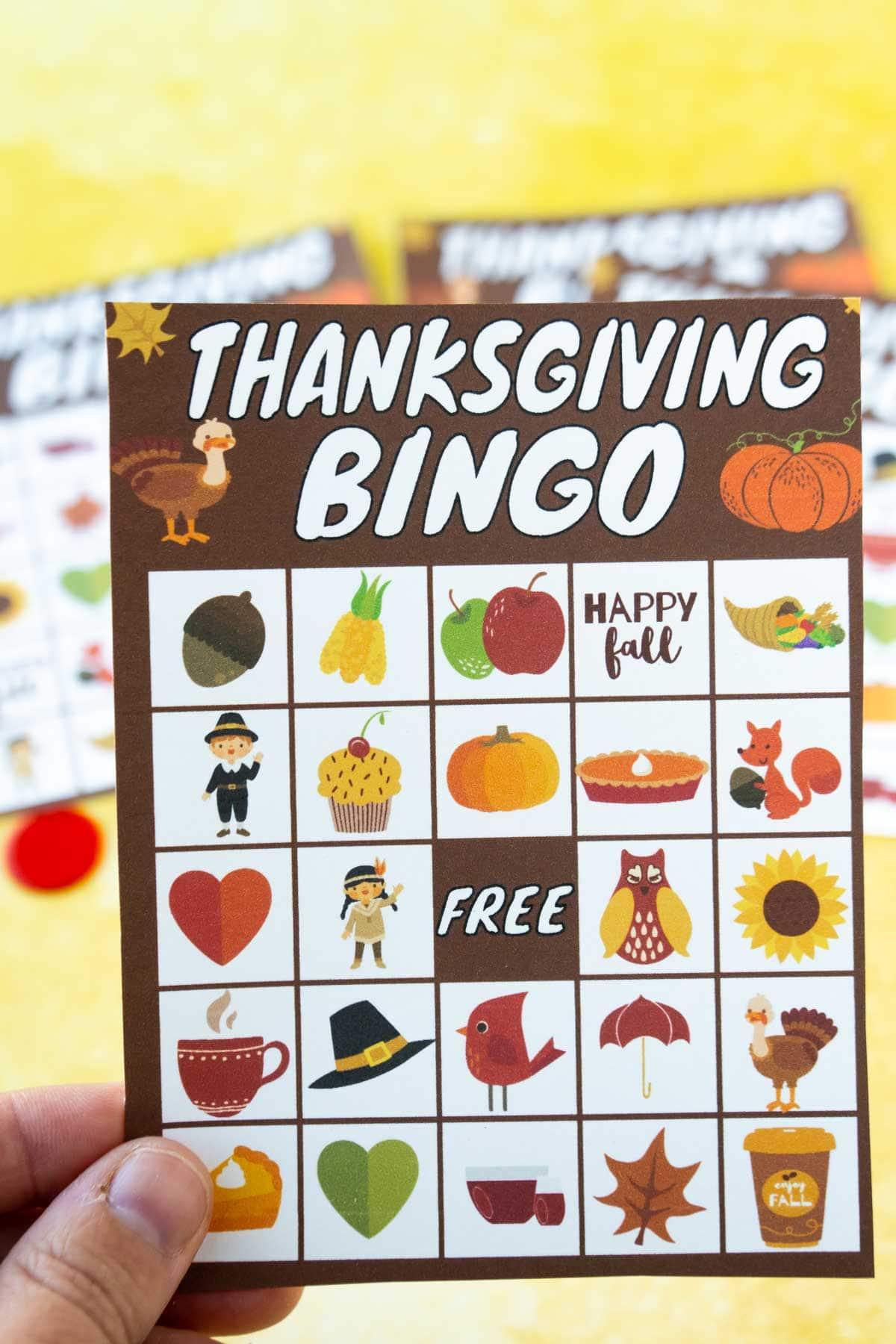 Woman's hand holding a Thanksgiving bingo card