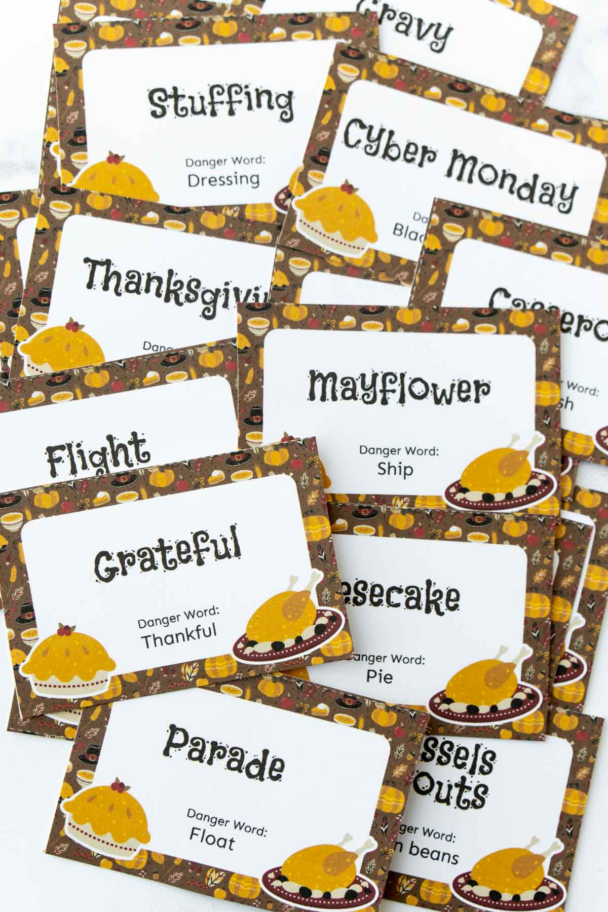 Thanksgiving danger word cards cut out and put in a pile