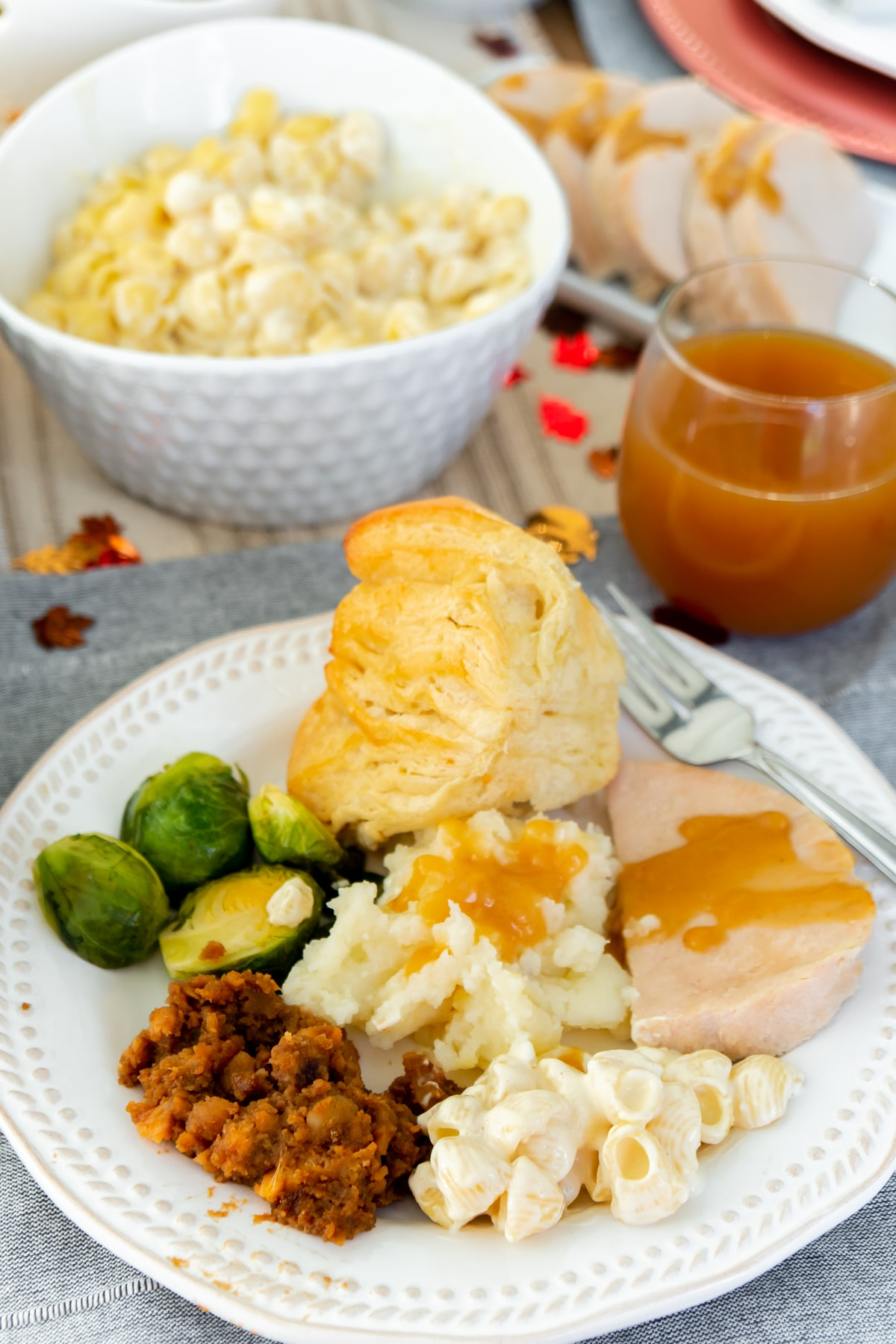 A white plate with a variety of Thanksgiving foods on it