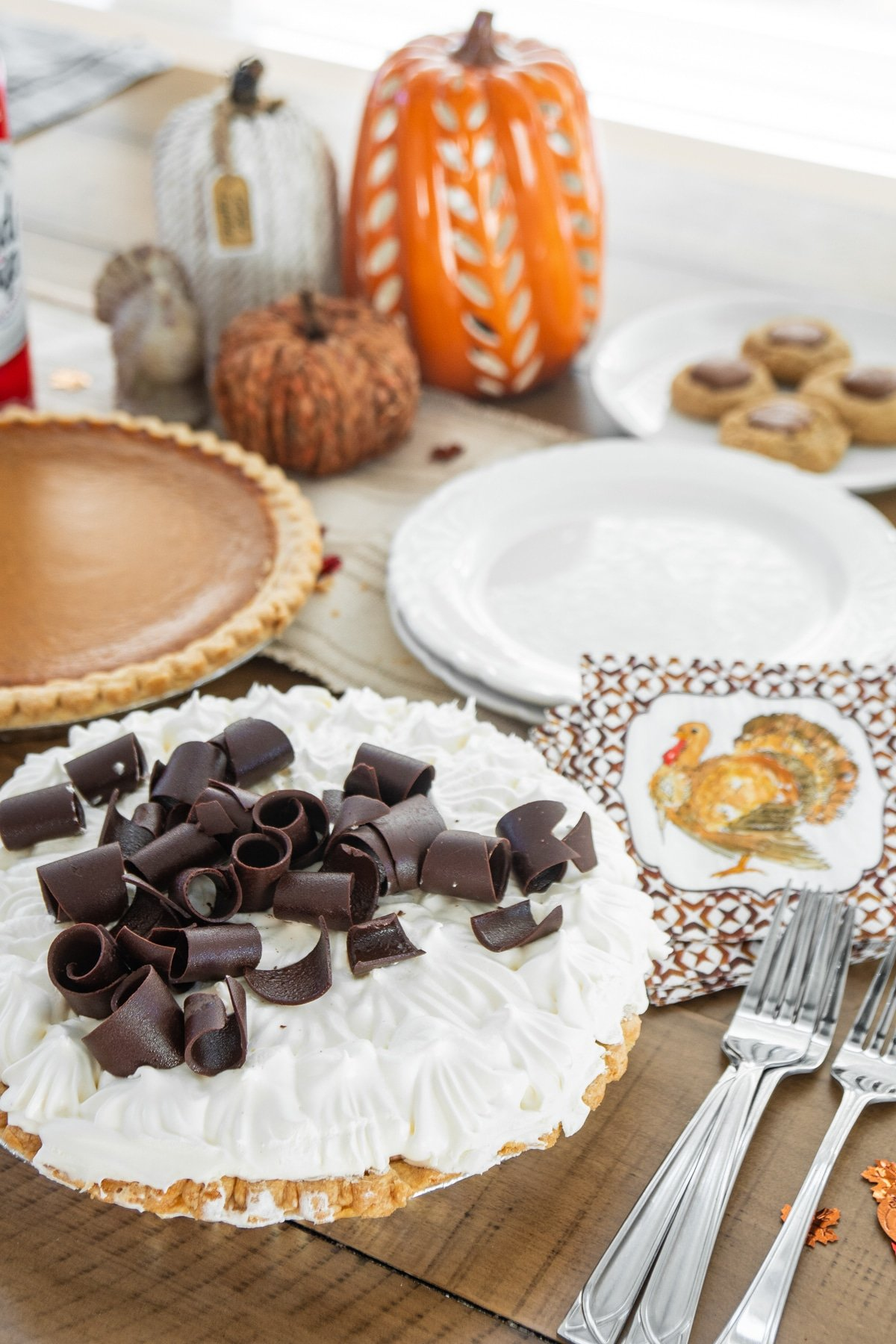 Chocolate and pumpkin pie on a table with forks