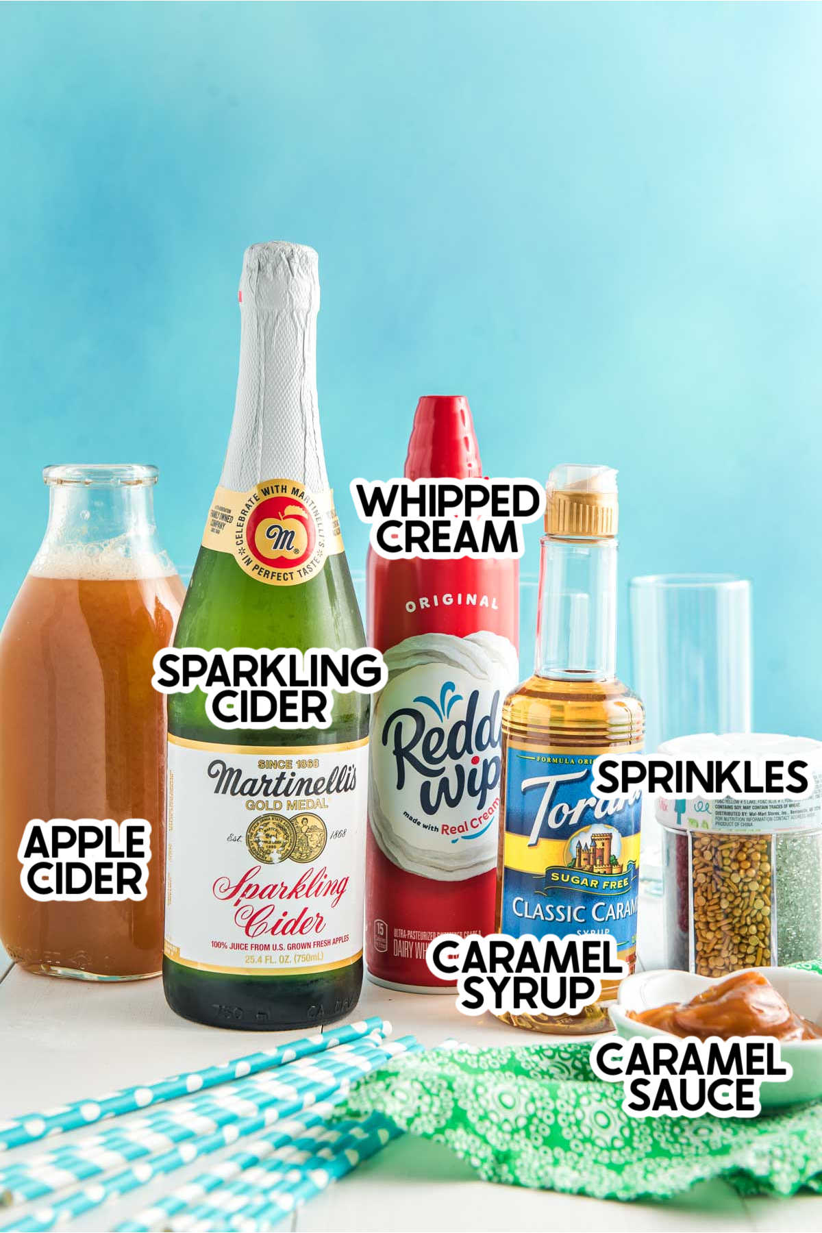 Ingredients needed for a caramel apple drink with labels