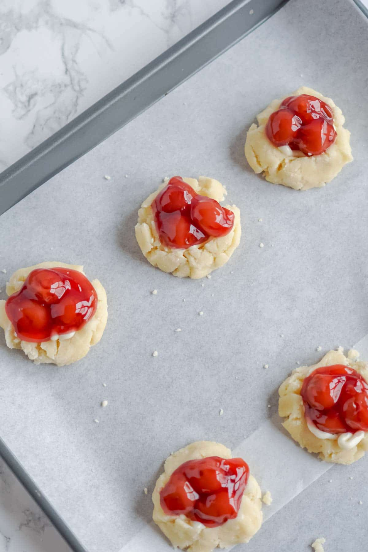 Sugar cookies with cherry pie filling on top