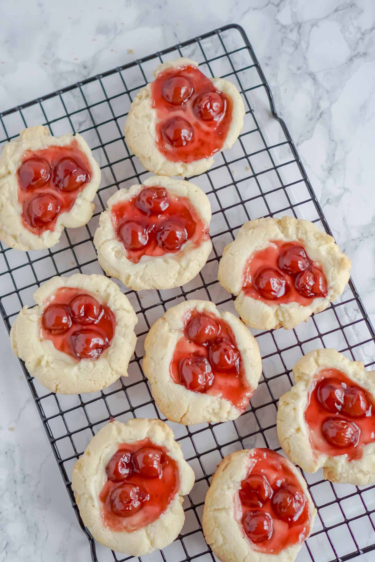 cherry cheesecake cookies on a cooling rack