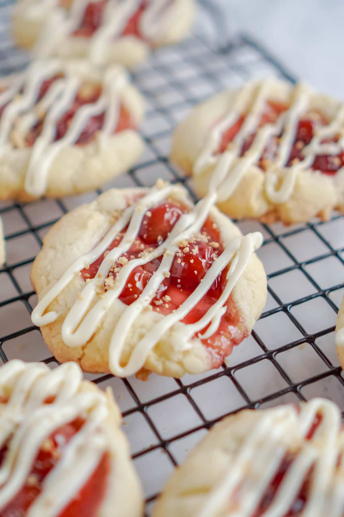 Cherry cheesecake cookies with cream cheese drizzled on top