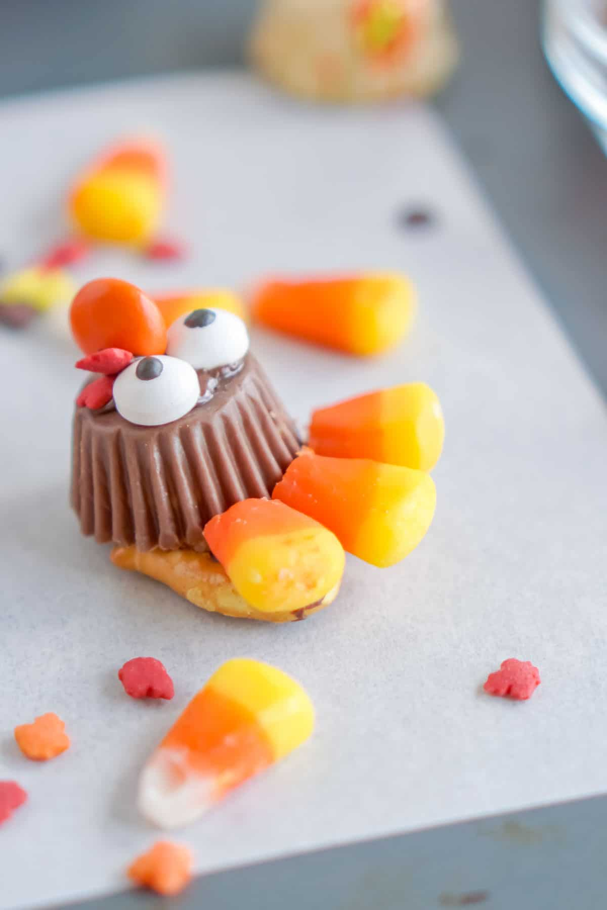 Chocolate turkey with candy corn being added
