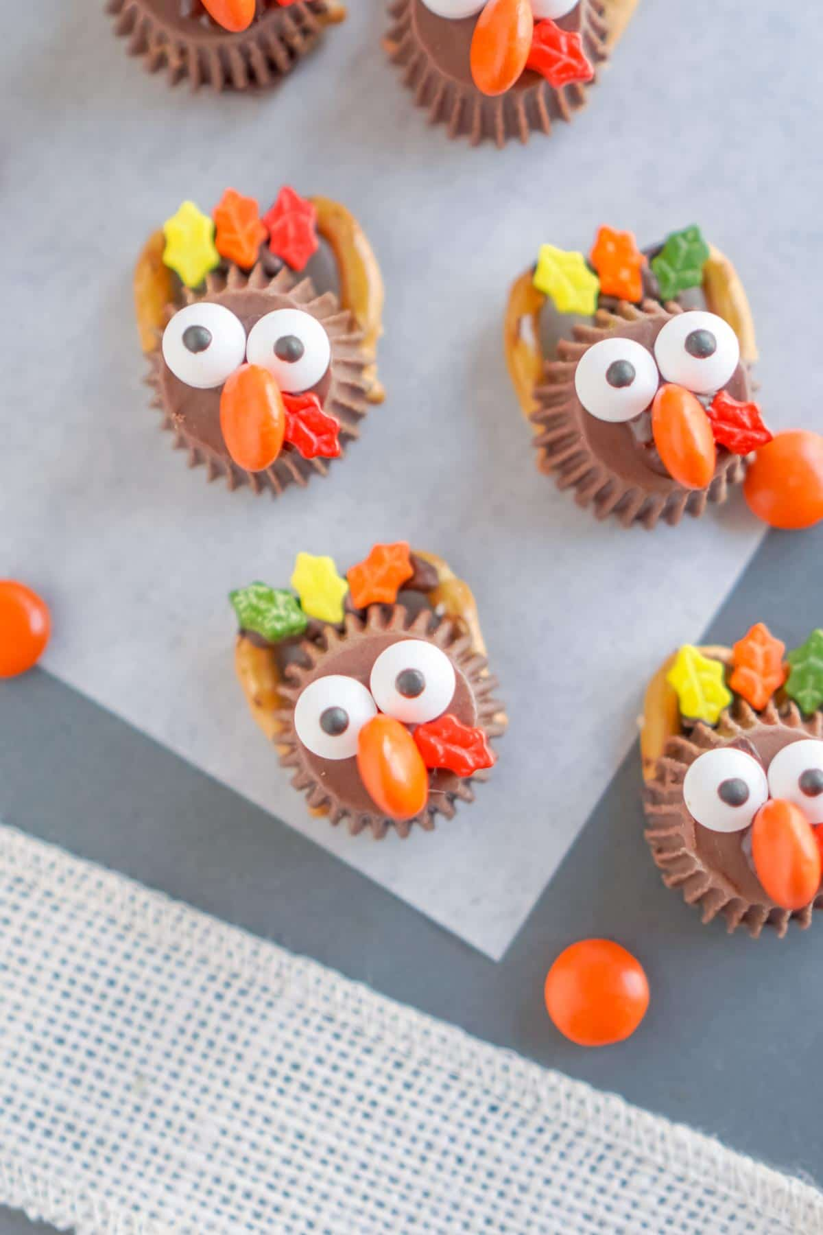 Four chocolate turkey treats on a piece of parchment paper