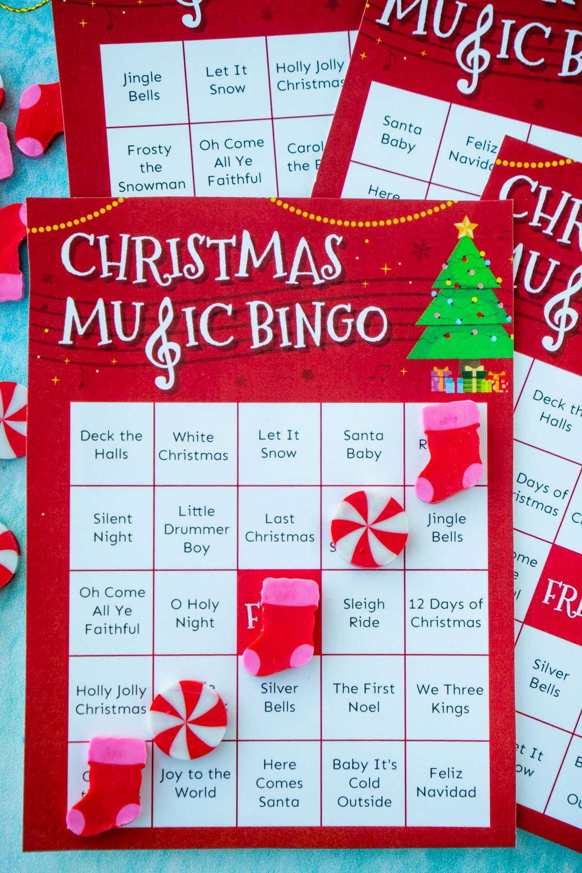 Christmas music bingo card with a bingo made out of Christmas erasers