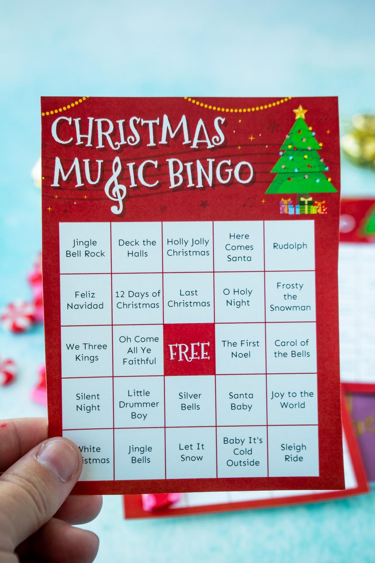 Hand holding a Christmas music bingo card