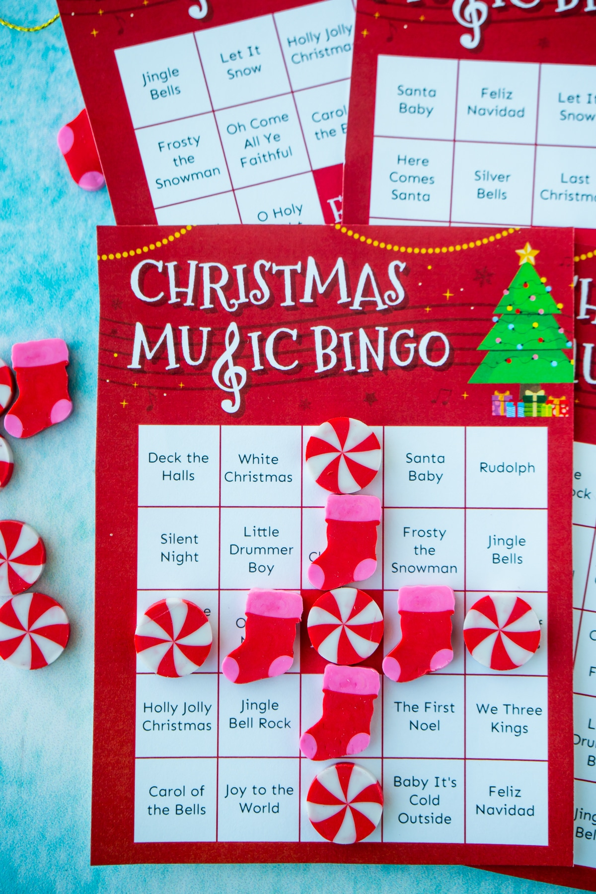 Christmas music bingo cards with a T of Christmas erasers