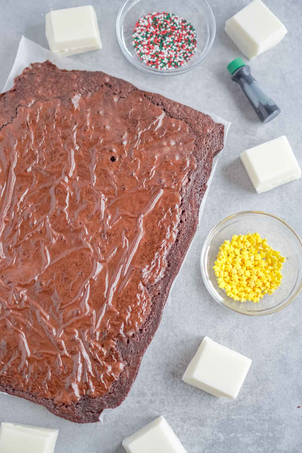 Brownies surrounded by white chocolate and sprinkles