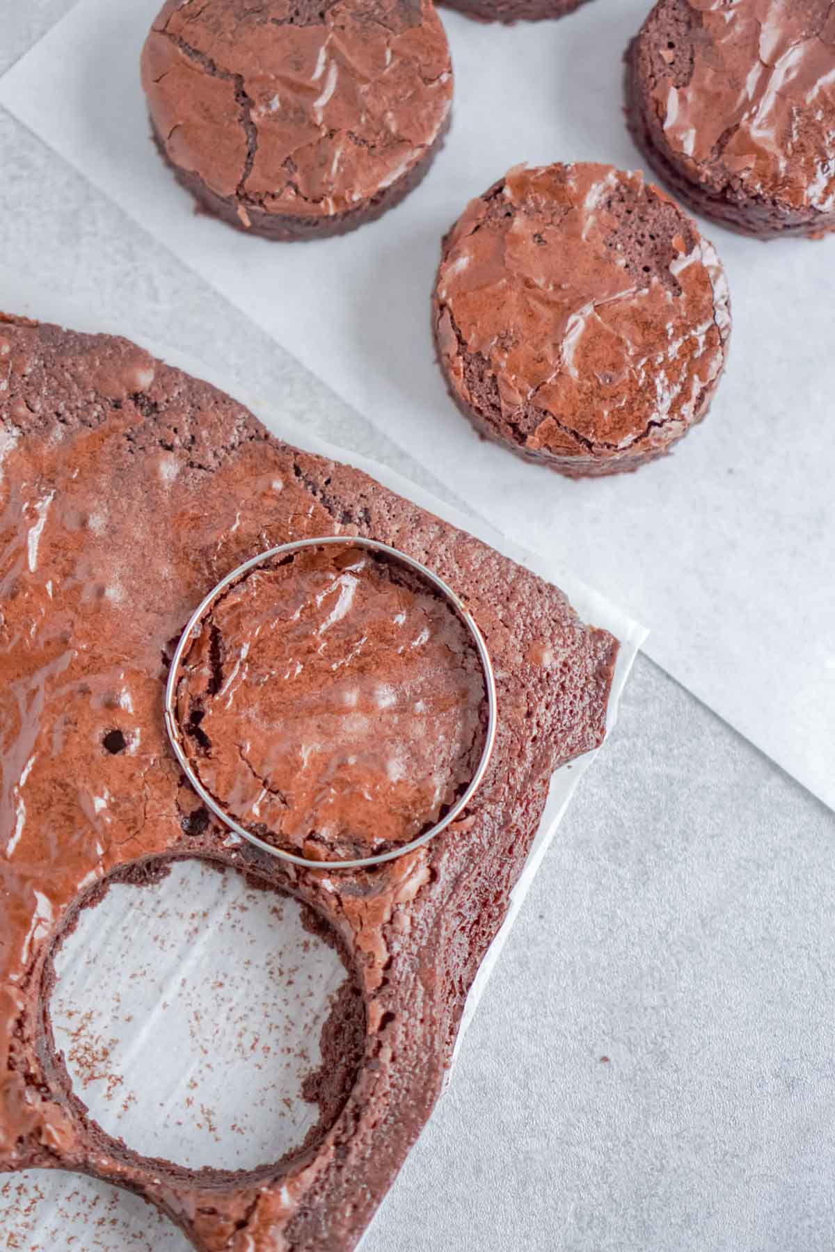 Circle cookie cutter on a thing of brownies
