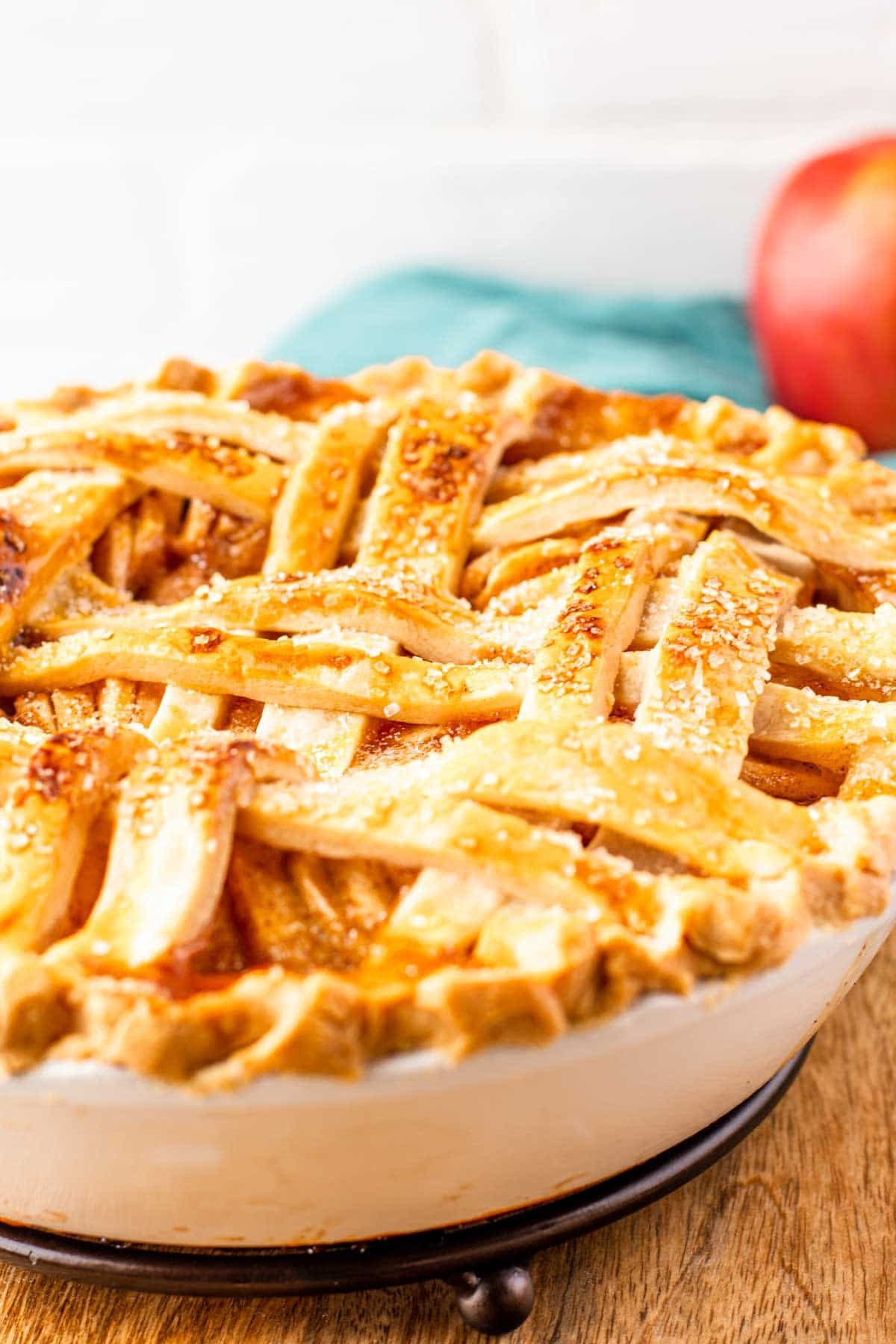 A pie with a basket weave flaky pie crust on top