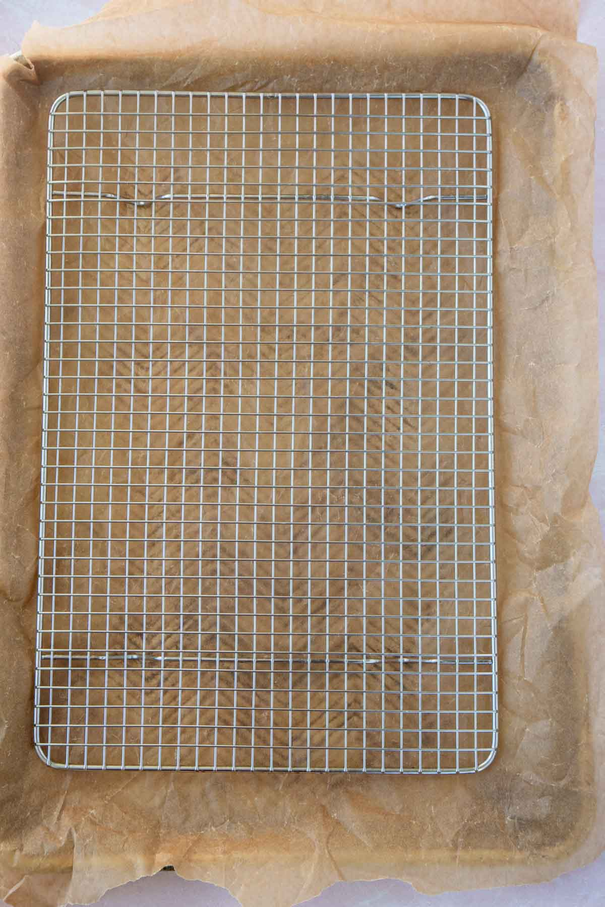 Metal rack on top of parchment paper on a baking sheet