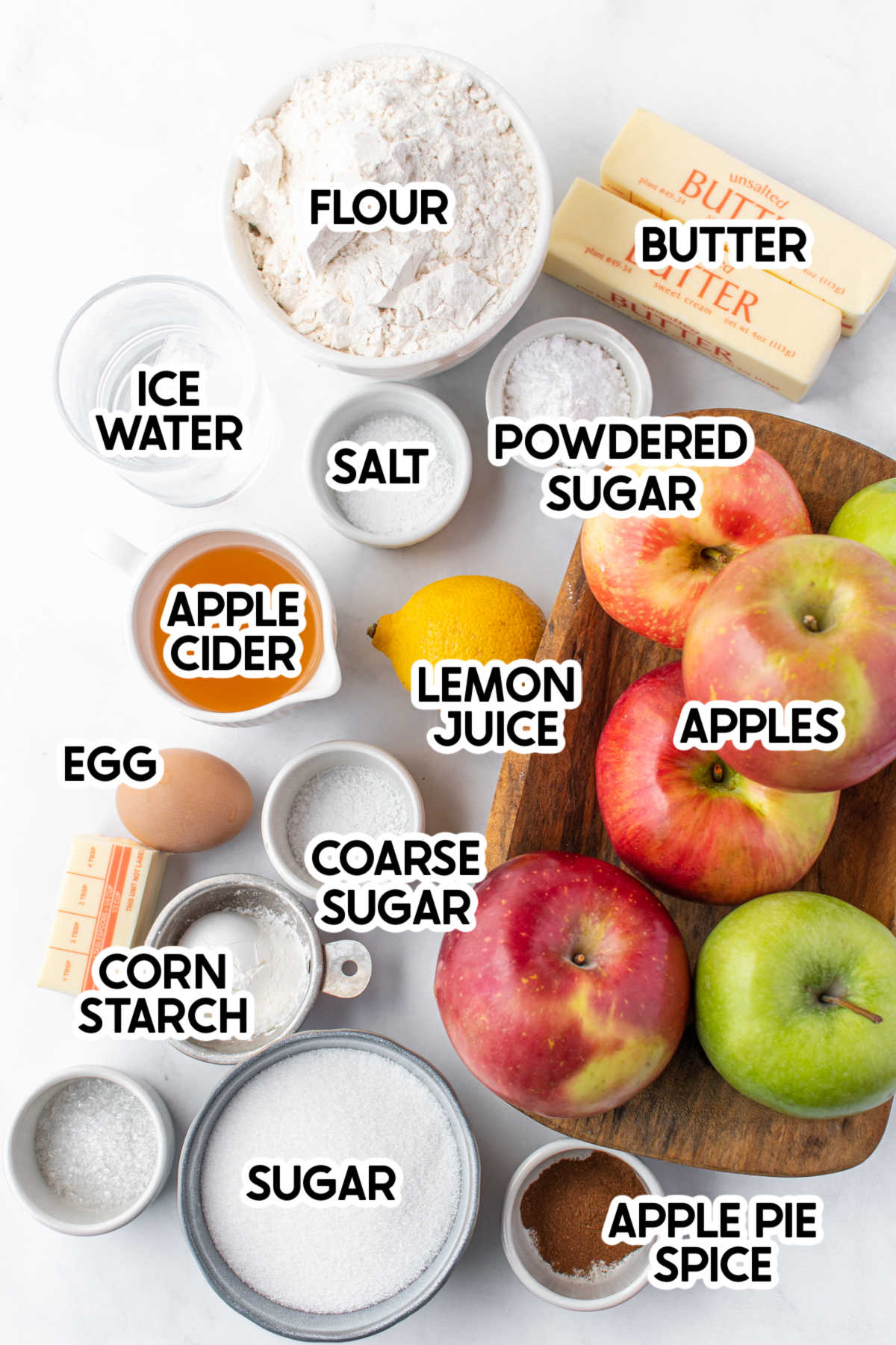 Ingredients for homemade apple pie with labels