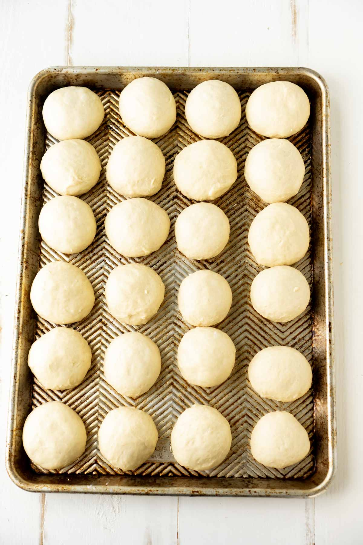 A sheet of homemade yeast rolls ready to be baked