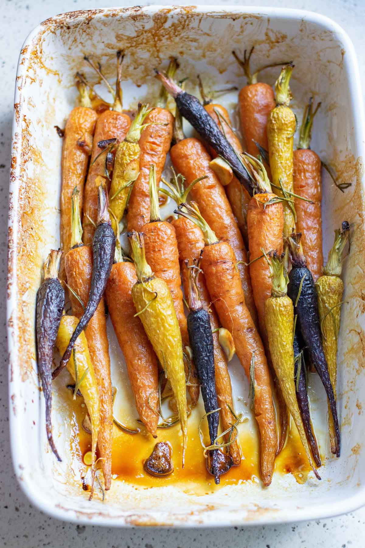 Honey roasted carrots in a white rectangle baking dish
