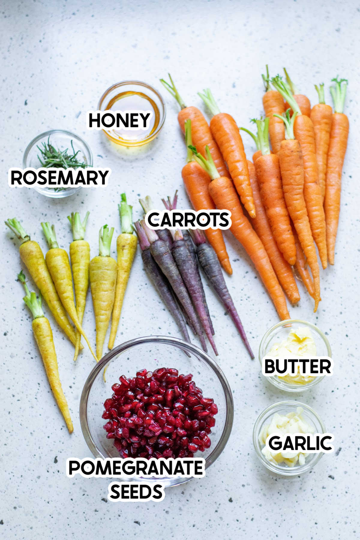 Ingredients needed for honey roasted carrots with labels