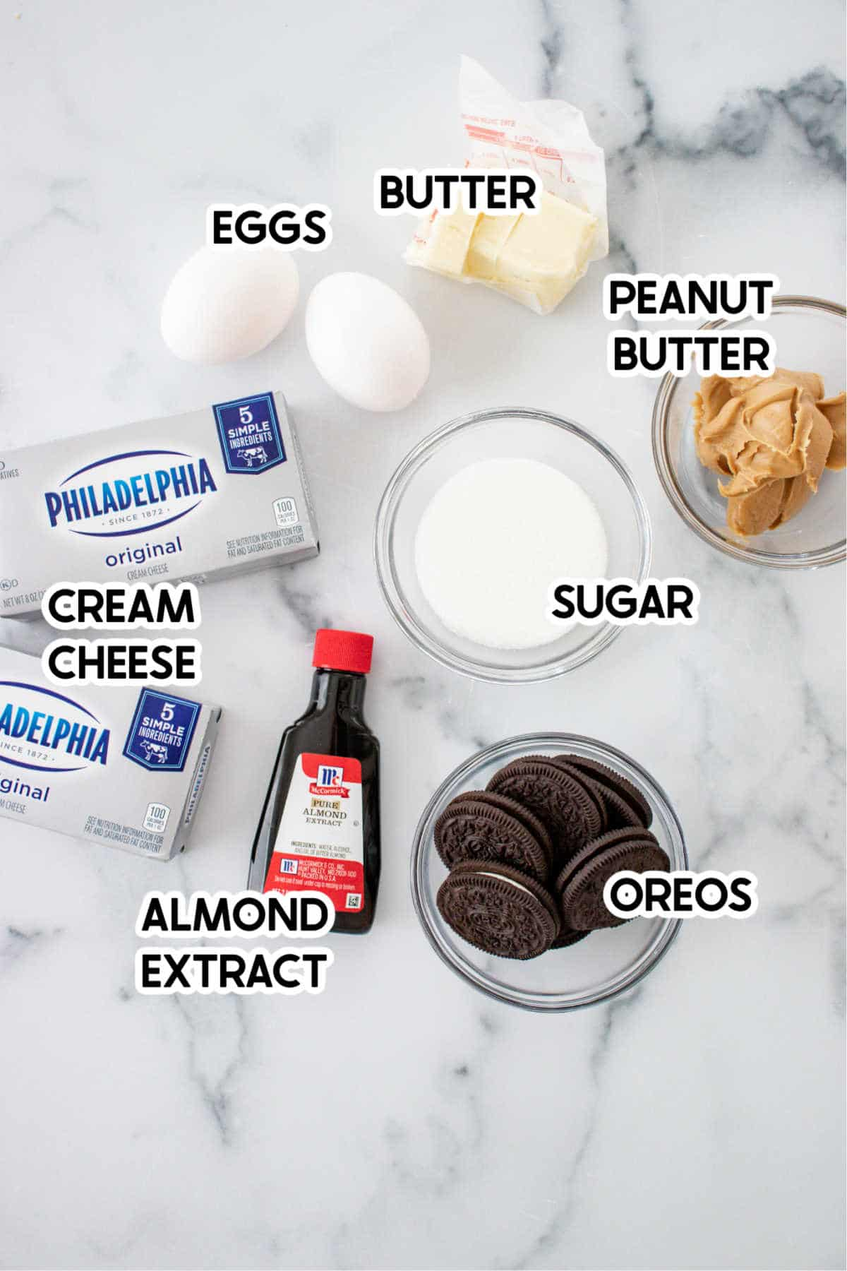 Ingredients to make mini Oreo cheesecakes with labels