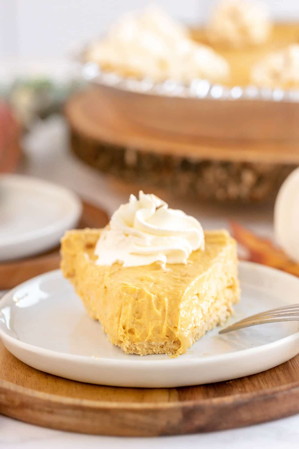 A slice o no bake pumpkin pie on a plate