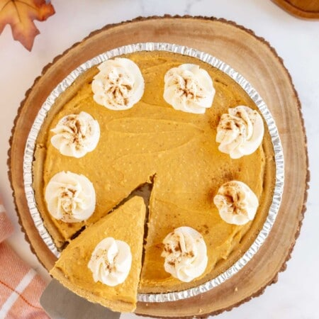 No bake pumpkin pie topped with whipped cream and cinnamon