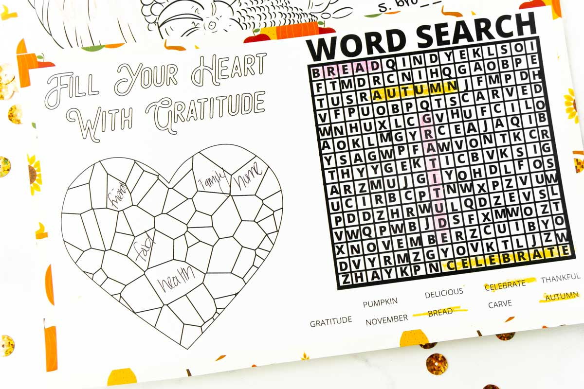 Thanksgiving placemat with a word search and heart on it