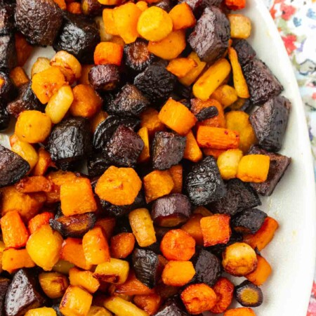 A white bowl filled with roasted root vegetables