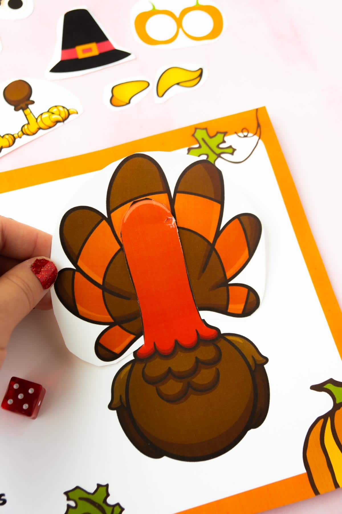 Hand holding turkey feathers on a roll a turkey game