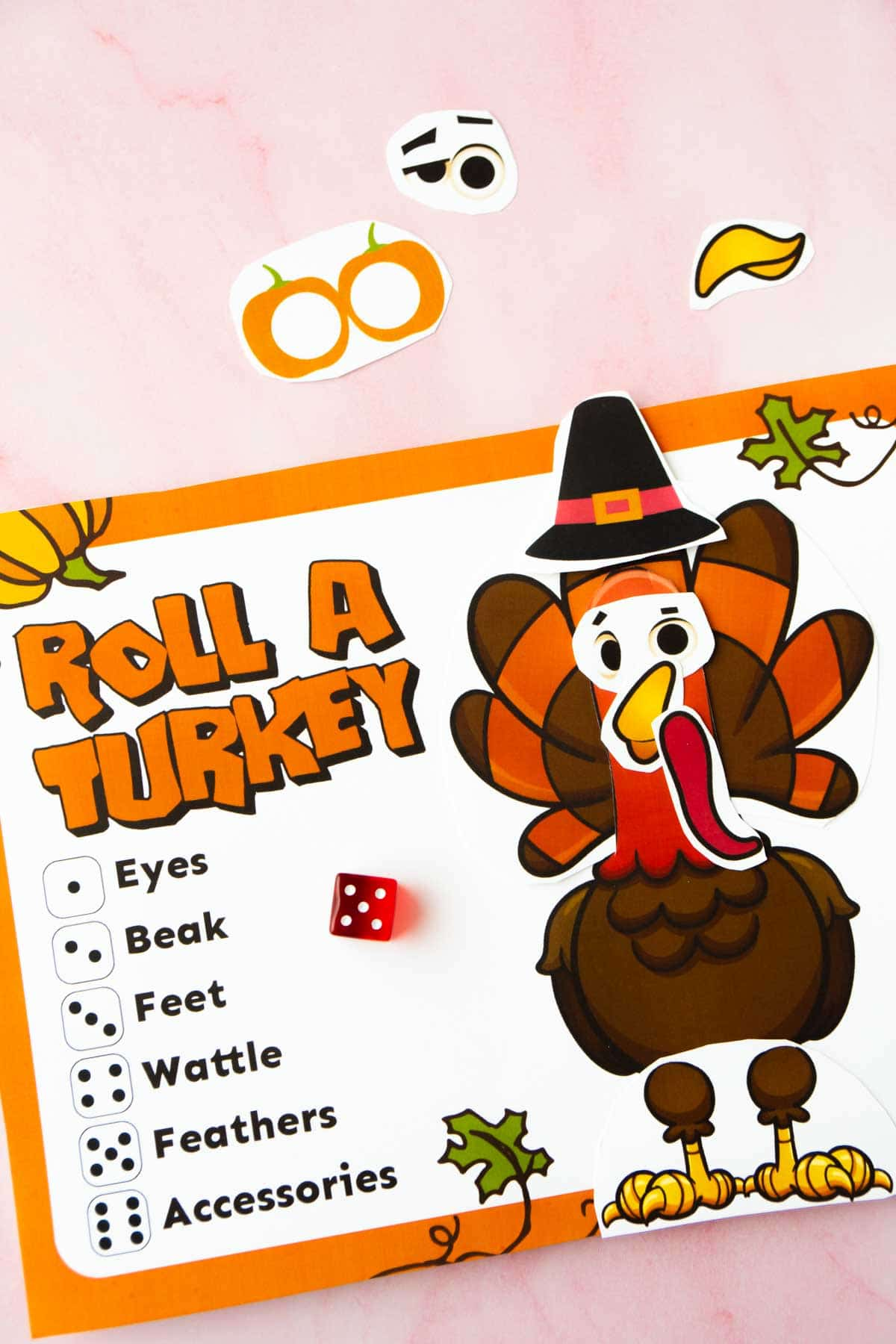 A printed out roll a turkey game with all the pieces added