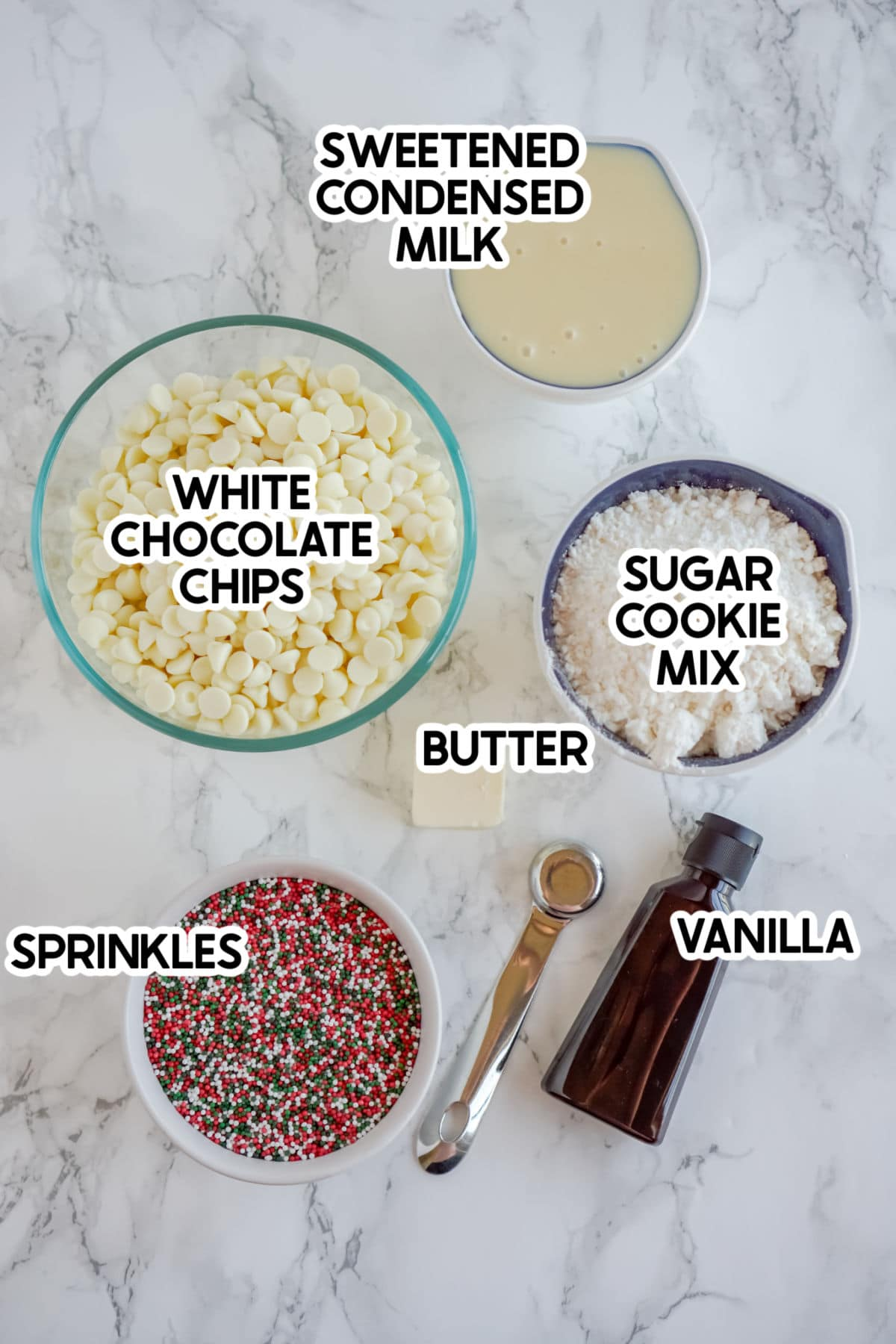 Ingredients to make sugar cookie dough fudge with labels