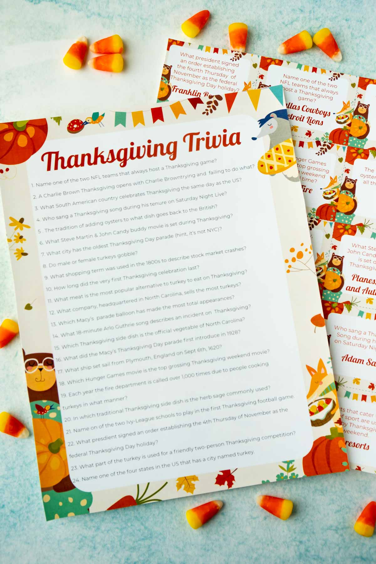 A list of Thanksgiving trivia questions on top of trivia cards