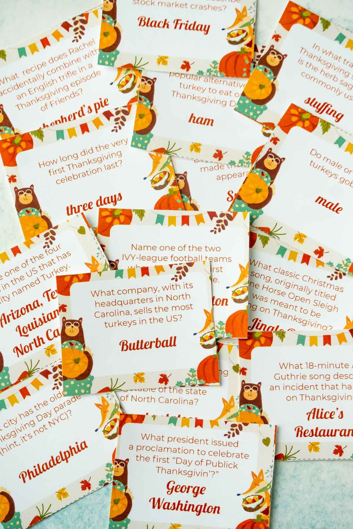 Pile of cards with Thanksgiving trivia questions on them